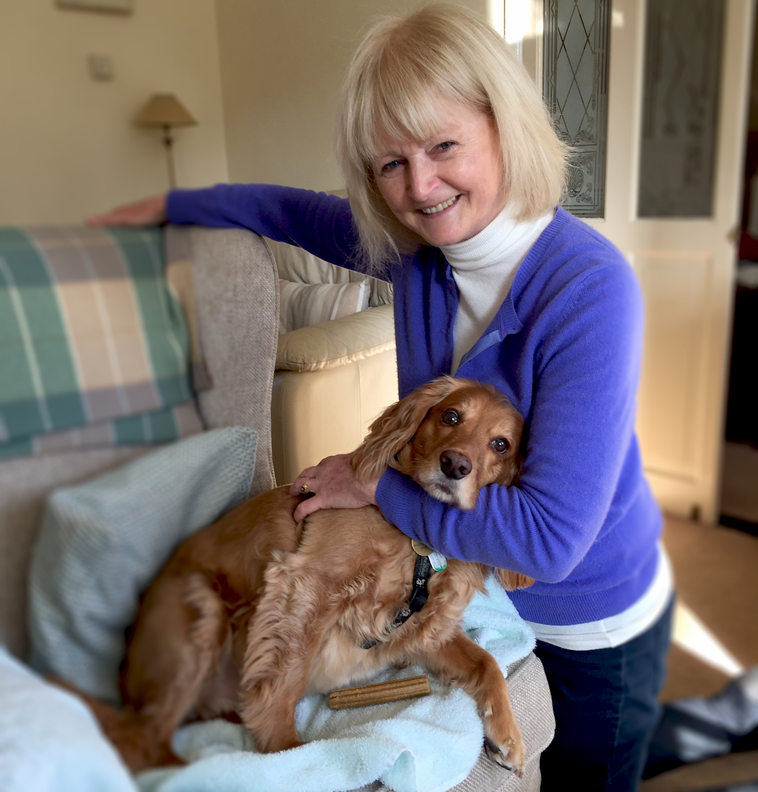 West Sussex Dog Carer Pam enjoying a cuddle with her guest dog Charlie