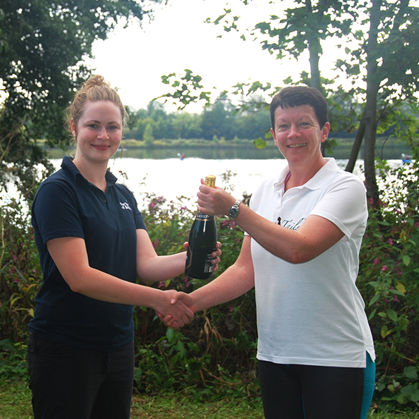 2015 Take the Plunge top fundraiser Lizzie receives her bottle of champagne