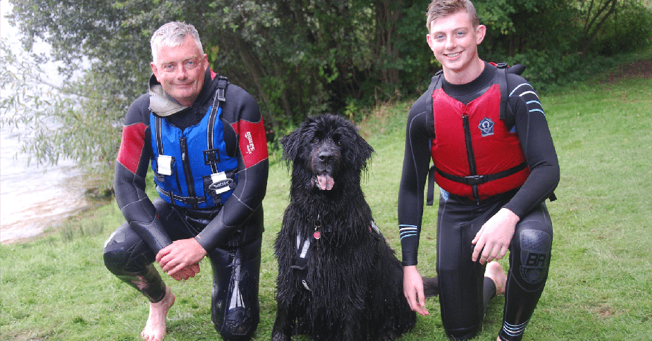 Top junior fundraiser Tom Ford pictured with a Newfoundfriend rescue dog and his father post rescue at Take the Plunge II