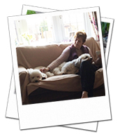 Kobe and Tinkerbell relaxing with dog carer Carole on their Reading dog boarding holiday