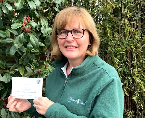 Shirley Lilley of Wagging Tails Peterborough with her Animal Aiders First Aid Training certificate