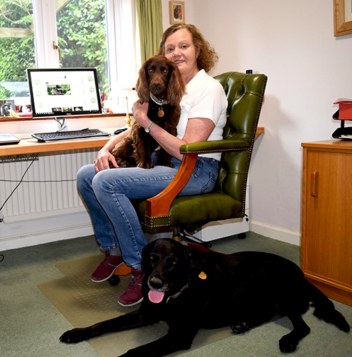 Digby and Tyler in the Wagging Tails office with Teresa in Oxfordshire